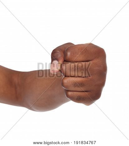 Fight hand gesture. Black man clenched fist, ready to punch, isolated on white, close-up, copy space