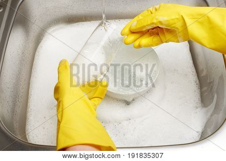 Hands In Gloves Washing Drinking Glass Under Running Tap Water