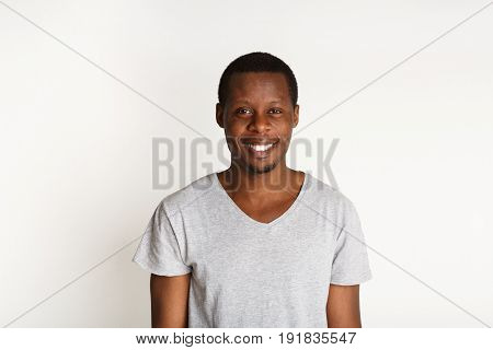 Welcoming smile. Black man smiling on white background, studio shot, copy space