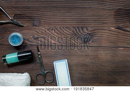 manicure preparation set with nail polish bottles on wooden table background top view space for text