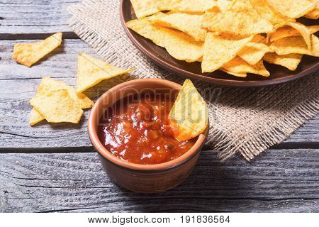 Snack for party chips nachos with tomato sauces