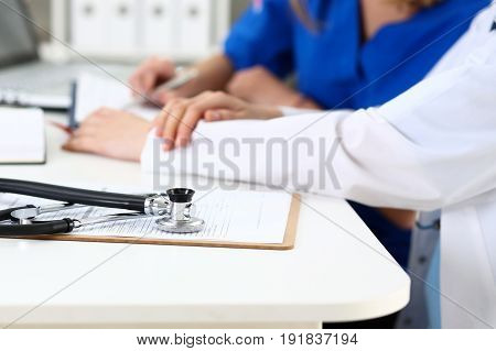 Stethoscope Head Lying On Medical Forms Closeup