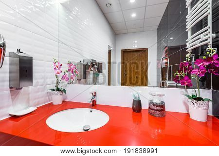 Bathroom With Red Countertop