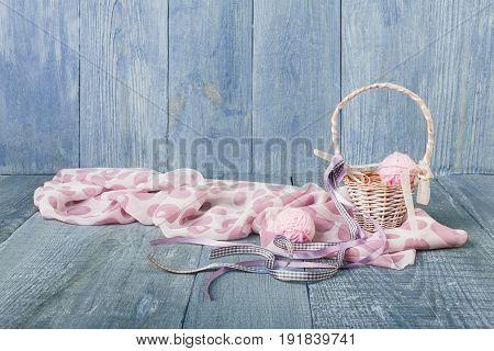 Yarn balls in basket. Knitwork background. Art craft, hand made. Handiwork, knitting needlework