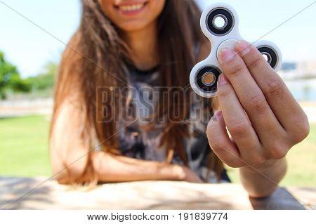 Smiling Women holds a white spinner in the garden