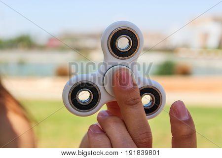 Women Hand Hold A White Spinner