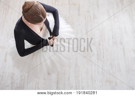 Classical Ballet dancer. Beautiful graceful ballerina in tutu, top view on white