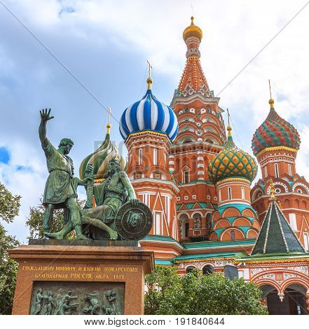 St. Basils cathedral and monument to Minin and Pozharsky on Red Square in Moscow Russia The translation of the words on monument is 'To Citizen Minin and prince Pozharsky from thankful Russia. Year 1818'