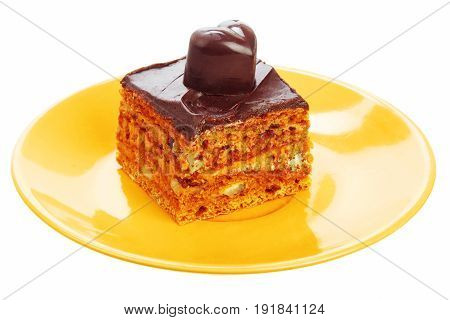 Chocolate cake on orange plate isolated on a white background