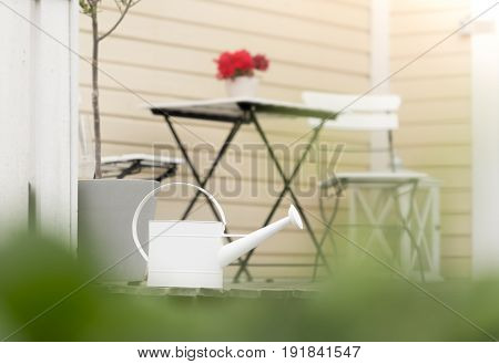 Garden chairs table flower pot and house. Sweden Europe Scandinavia.