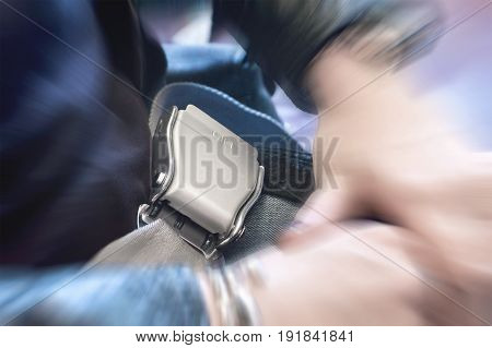 Close up of fastened airplane seat belt with dramatic zoom effect. Woman sitting in aeroplane waiting for take off.
