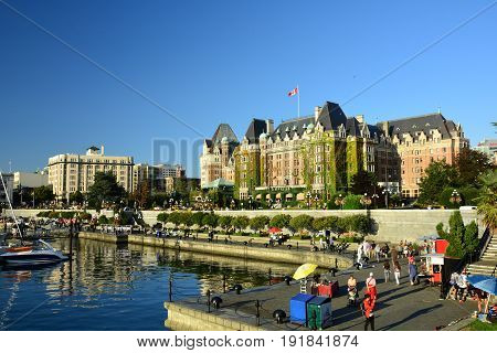 Victoria BC,Canada,May 23rd 2014.The Empress hotel and the inner harbor and marina in Victoria BC.These  iconic Victoria landmarks are always busy with people and activities.Come to the island and enjoy.