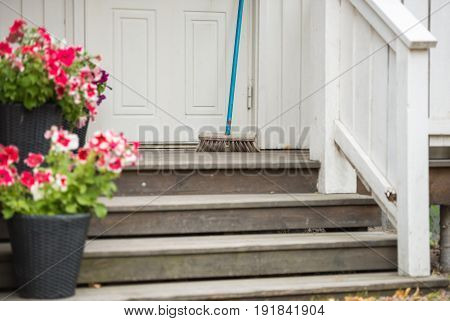 Terrace of white swedesh house with flower pots on steps. Sweden Scandinavia Europe.