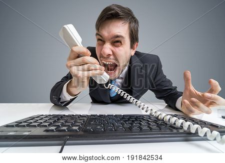 Angry Boss Or Manager Is Calling And Shouting To The Telephone.