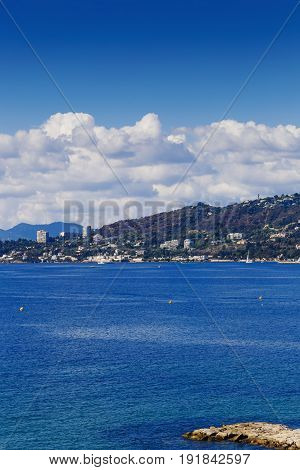 JUAN LES PINS FRANCE - September 22th 2016: Blue Mediterranean landscape on a warm serene summer day shot in Juan Les Pins on the French Riviera