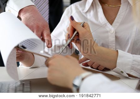Group Of People Deliberate On Problem With Clipboard