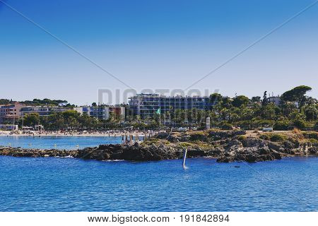 Mediterranean Landscape And Detail Of The Beach And Coastline Of Antibes