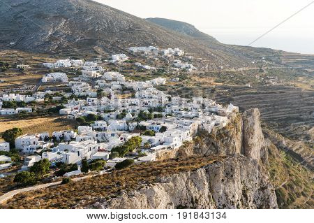 The city of Chora on Folegandros island Greece placed on the edge of a steep cliff
