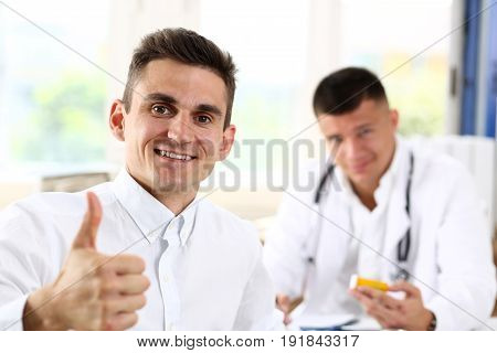 Man Showing Ok Sign With Thumb Up At Physician Office Portrait