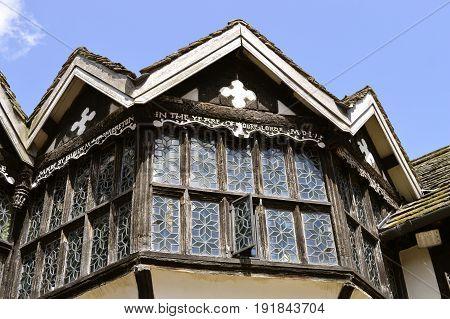 Congleton; Cheshire; England United Kingdom - June 17 2017 : Little Moreton Hall stained glass windows
