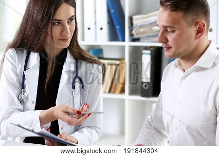 Female Doctor Hand Hold Silver Pen And Showing Padbeautiful Female Medicine Doctor Explain Diagnosis