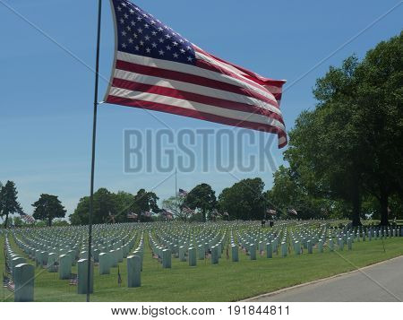 US flags at Fort Gibson National Cemetery A big United States flag and small US flags beside the tombstones at the Fort Gibson National Cemetery in Muskogee, Oklahoma