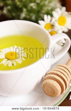 A lovely fresh cup of Chamomile tea with a touch of honey.