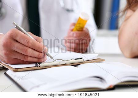 Male Medicine Doctor Hand Hold Jar Of Pills
