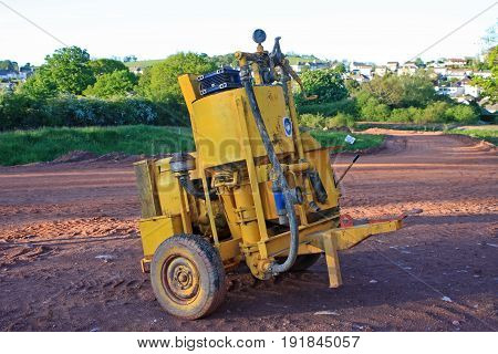 Air compressor on a road construction site