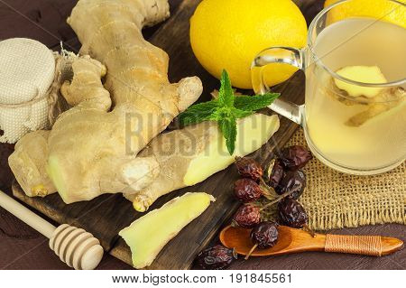 Ginger tea. Natural treatment for colds and flu. Ginger lemon honey and rosehip tea against influenza