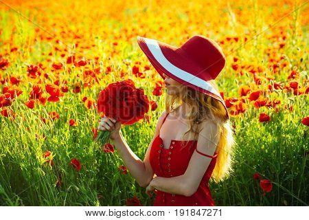 Pretty Girl In Field Of Poppy Seed In Retro Hat