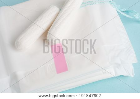 Menstrual Tampons And Pads On A Blue Background. Menstruation Time. Hygiene And Protection