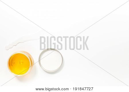 Wax for depilation on white background top view copyspace.