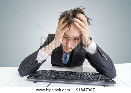 Tired Or Bored Man Is Working With Computer And Solving A Proble