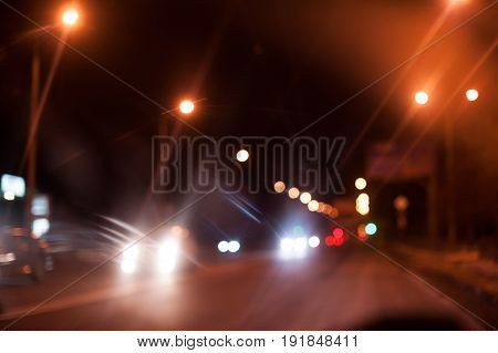 Night city cars defocus and lights on road.