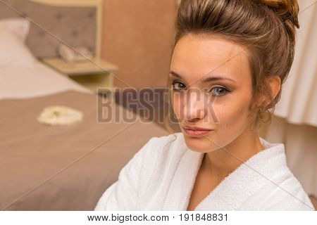 charming girl with beautiful make-up in white coat