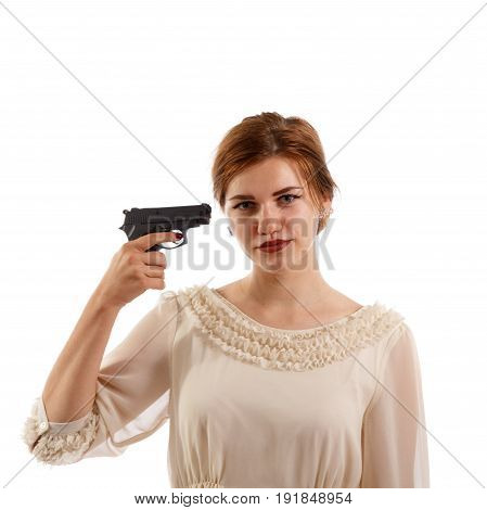 A young lady pointing a handgun at herself