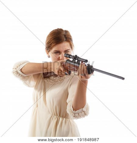 A young lady in a white dress aiming a rifle