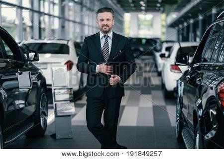 Top sales manager at dealership showroom
