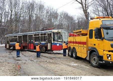 MOSCOW, RUSSIA - DEC 21, 2016: Evacuation of damaged tram from site of accident, in 2016 in Russia there were 184 thousand accidents with victims, they killed 23 thousand people