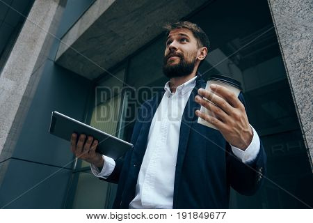 Surprised businessman, businessman holding a glass of coffee, businessman with phone.