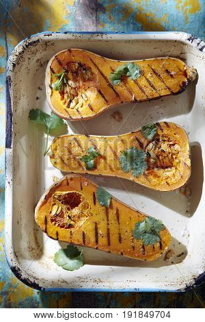 Roasted butternut squash with coriander in baking dish