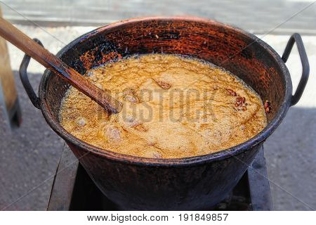 Pot of caramel, making sugared almonds, Sineu market, Spain