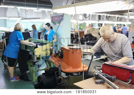 MOSCOW - FEB 21, 2017: Conveyor with modern shoes in workshop in Ralf Ringer factory. Company production is 1,5 million pairs per year