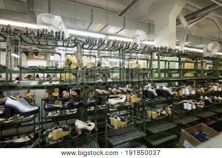 MOSCOW - FEB 21, 2017: Conveyor with shoes pairs in workshop in Ralf Ringer factory. Company production is 1,5 million pairs per year