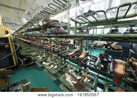 MOSCOW - FEB 21, 2017: Conveyor with shoes in workshop in Ralf Ringer factory. Company production is 1,5 million pairs per year