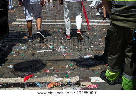 Wash streets after festival San Fermin, Pamplona, Navarra, Spain, 06 July 2016. Crash on street after festival, garbage.