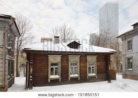 MOSCOW - DEC 9, 2016: Empty old street and modern building far away at winter, Decoration Old Moscow was built in 2003 for filming of Mosfilm Studio