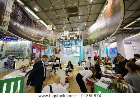 MOSCOW - MAR 16, 2017: People at real estate exhibition in Central House of Artists, 200 companies took part in exhibition