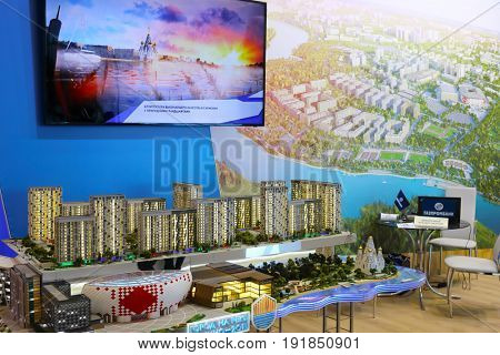 MOSCOW - MAR 16, 2017: Miniature of residential district near river at real estate exhibition in Central House of Artists, 200 companies took part in exhibition
